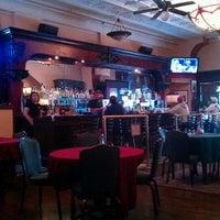 Photo taken at Merchants Cafe & Saloon by Dan G. on 8/14/2011