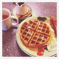 Photo taken at Cafe Reva by Patrick D. on 12/18/2011