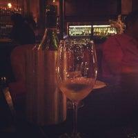 Photo taken at D' vine Wine Bar & Tapas by Nongnat P. on 3/9/2012