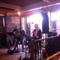 Photo taken at Mick Kelly's Irish Pub by Erik W. on 3/17/2012