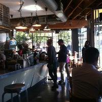 Photo taken at BrainWash Cafe & Laundromat by Idan B. on 11/14/2011