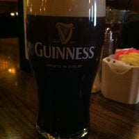 Photo taken at Rí Rá Irish Pub by Dan K. on 12/30/2011
