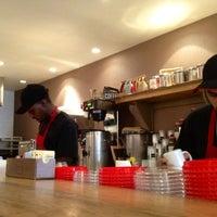 Photo taken at Aroma Espresso Bar by Scott B. on 3/29/2012