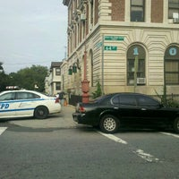 Photo taken at NYPD - 104th Precinct by Lauren C. on 8/21/2012