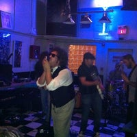 Photo taken at News Cafe by Spencer D. on 10/15/2011