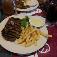 Photo taken at Holycow! Steakhouse by Meutia H. on 12/9/2011
