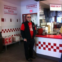 Photo taken at Five Guys by Adrian B. on 4/28/2012