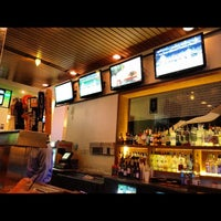 Photo taken at The Over/Under Bar & Grill by Doug B. on 9/12/2012