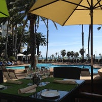 Photo taken at The Waterfront Beach Resort, a Hilton Hotel by Cara J. on 3/19/2012