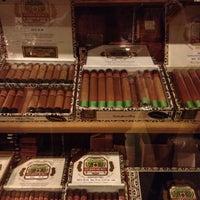 Photo taken at King Corona Cigars Cafe & Bar by Yuki R. on 2/18/2012