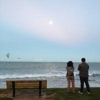 Photo taken at Mairangi Bay Beach by Carla A. on 4/5/2012