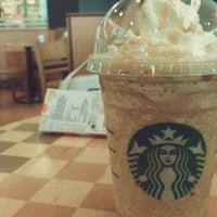 Photo taken at Starbucks by Caenne N. on 5/5/2012