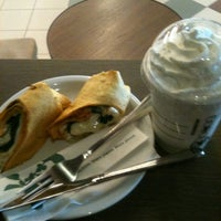 Photo taken at Starbucks by Karolina J. on 3/30/2012