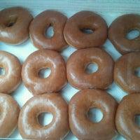 Photo taken at Krispy Kreme Doughnuts by Karm on 6/24/2012