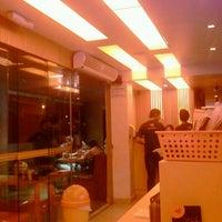 Photo taken at Koni Store by Flávia M. on 4/16/2012