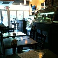 Photo taken at The Path Cafe by Viviane P. on 4/16/2012