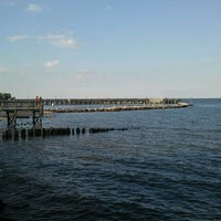 Photo taken at North Beach Boardwalk by Eric A. on 8/18/2012