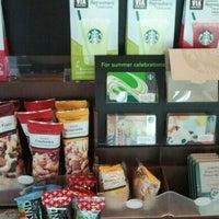 Photo taken at Starbucks by Stella B. on 7/18/2012