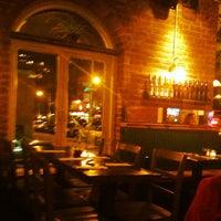 Photo taken at Sidewalk Bar & Restaurant by Kendra A. on 4/9/2012