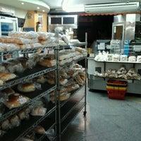 Photo taken at Confeitaria Flor do Rink by Renato R. on 10/1/2011