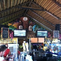 Photo taken at The Hut Bar and Grill by Todd N. on 7/17/2011