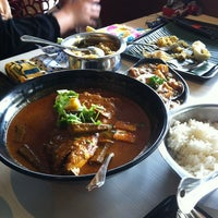Photo taken at Muthu's Curry Restaurant by MFauzie O. on 2/5/2012