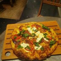 Photo taken at La Grande Orange Grocery & Pizzeria by Matt M. on 8/8/2012