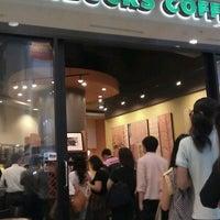 Photo taken at Starbucks by Kaoru T. on 1/19/2012