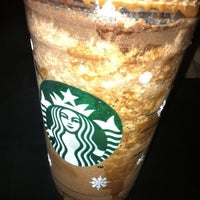 Photo taken at Starbucks by angeline t. on 11/13/2011