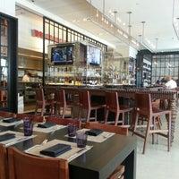 Photo taken at Wolfgang Puck Bar & Grill by Gordon N. on 9/4/2012