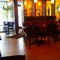 Photo taken at Le Oriental Bistro by Derek W. on 12/22/2011