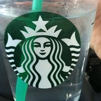 Photo taken at Starbucks by Sarah D. on 3/6/2012