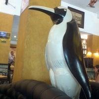 Photo taken at Pinguim by Larissa M. on 2/12/2012
