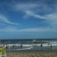 Photo taken at Praia dos Paraguaios by Priscila D. on 1/2/2012