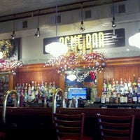 Photo taken at ACME Bar & Grill by Cassie H. on 12/19/2011