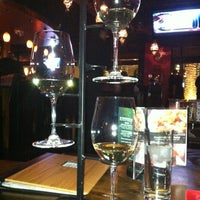 Photo taken at Double Helix Wine & Whiskey Lounge by Wendy c. on 3/17/2012