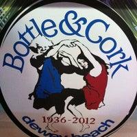 Photo taken at Bottle & Cork by Elle S. on 5/13/2012