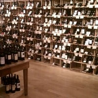 Photo taken at Cork Market & Tasting Room by Beaumont K. on 4/5/2012