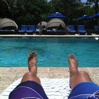 Photo taken at Jupiter Beach Resort & Spa by Jamie C. on 4/9/2012