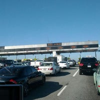 Photo taken at Bay Bridge Toll Plaza by Vince S. on 3/8/2012