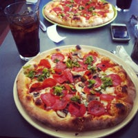 Photo taken at Il Vicino Wood Oven Pizza by Jacquelyn L. on 8/10/2012