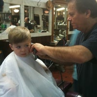 Photo taken at Park Slope Barbers by Lynn H. on 7/1/2011