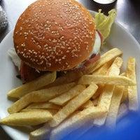 Photo taken at American Burger by Felipe M. on 8/14/2012