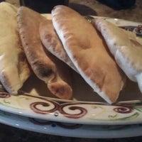 Photo taken at Paymon's Mediterranean Cafe & Hookah Lounge by Michelle M. on 7/11/2012