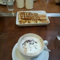 Photo taken at Xurros Café by Carolina Andrea G. on 7/16/2012