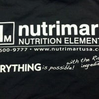 Photo taken at Nutrimart-Parkway Plaza by Eric G. on 11/20/2011