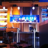 Photo taken at Blue Sushi Sake Grill by Karen S. on 1/18/2011