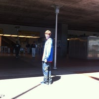 Photo taken at Emery Go-Round MacArthur BART Bus Stop by Mike F. on 9/7/2012