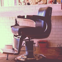 Photo taken at Rudy's Barbershop by Brad S. on 2/4/2012