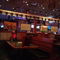 Photo taken at Smokey Bones Bar & Fire Grill by Cathleen C. on 3/25/2012